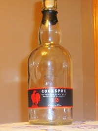 A well emptied Bottle of Cockspur 12