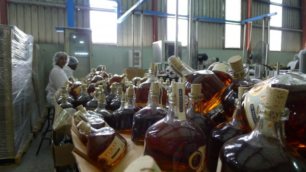 Hand Labeling Pyrat XO Reserve Rum at the Diamond Bottling plant in Guyana (Photo Credit Jamie Drummond)